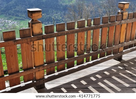 terrace with wooden railing of a mountain cottage - stock photo