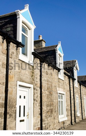 Terraced bungalows with attic rooms in a scottish town - stock photo