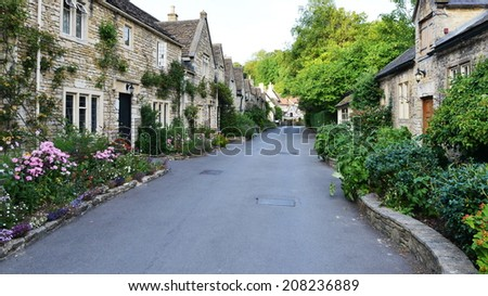 Terraced Cottages on a Leafy Lane through a Beautiful Old English Village  - stock photo