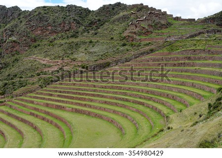 Terraced fields in the Inca archeological area of Pisac, Peru. The Inca constructed agricultural terraces on the steep hillside, which are still in use today. - stock photo