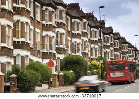 Terraced Houses and blured traffic at Clapham ,London. - stock photo