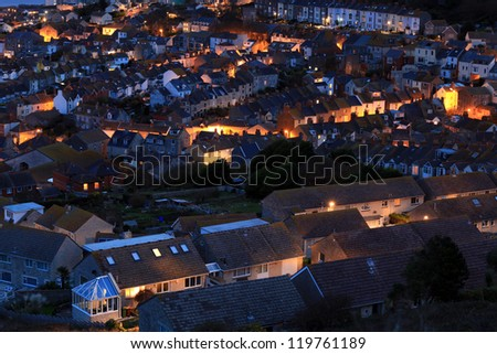 Terraced houses at night time on portland dorset - stock photo
