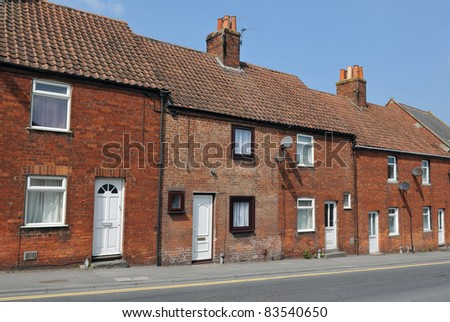 Terraced Red Brick Houses on an English Street - stock photo