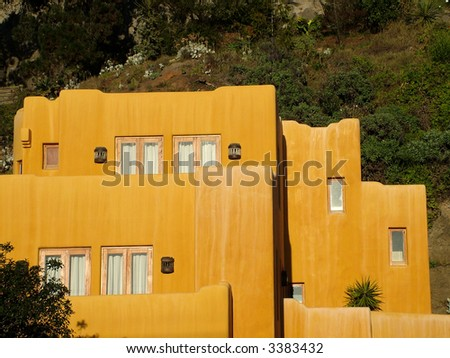 Terracotta colored house with a Mexican design - stock photo
