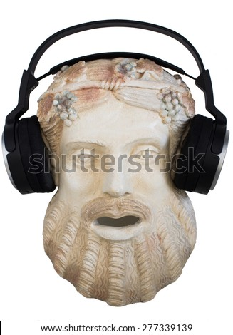 Terracotta Mask of Dionysus with Modern Wireless Headset. Ancient Greek God of theater, wine, fertility and religious ecstasy on white - stock photo