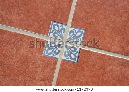 Terracotta tiles on the floor with a traditional Mexican pattern - stock photo