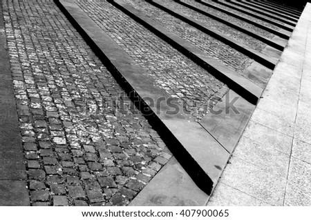 Terrain with cobblestone and concrete structures - stock photo