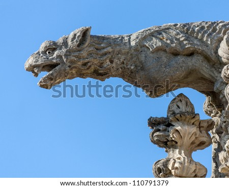 Terrible stone gargoyle on the facade of the Bussaco Palace - Portugal