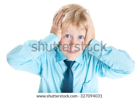 Terrified Caucasian blond boy in blue shirt holding his head with hands, isolated on white background - stock photo