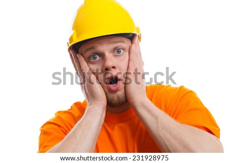 Terrified construction worker - stock photo