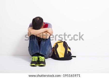 terrified student  sitting on the floor  - stock photo