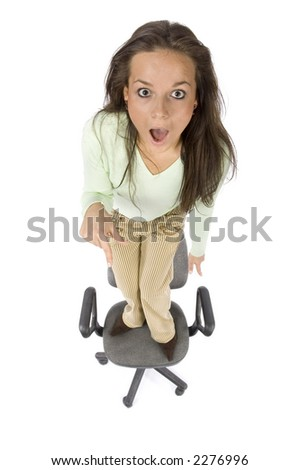 terrified woman standing on the office chair - white background, headshot - stock photo