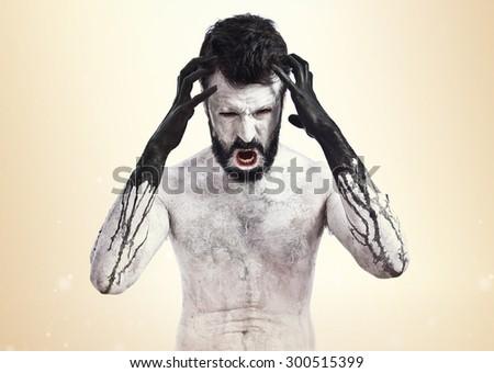 Terrifying Vampire  over ocher background - stock photo