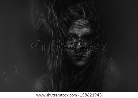 Terror, Scary, Portrait of young female beauty with long dark hair in black and white - stock photo