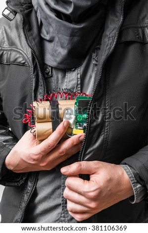 Terrorism concept. Terrorist has dynamite bomb in jacket. - stock photo