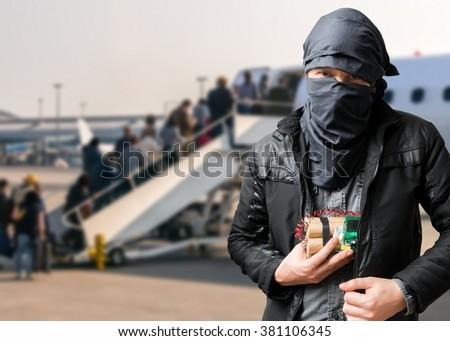Terrorist has dynamite bomb in jacket in airport. Terrorism concept. - stock photo