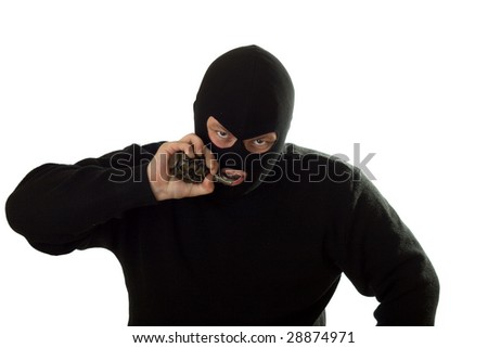 Terrorist in a black mask and sweater with grenade.