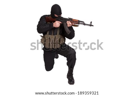 terrorist in black uniform and mask with kalashnikov isolated - stock photo