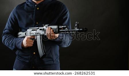 Terrorist is holding AKM 47 - stock photo