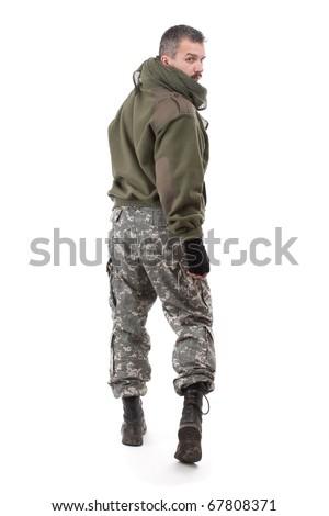 Terrorist looking over his shoulder - stock photo