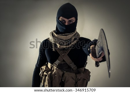 Terrorist menacing western countries on a tape. Concept about terrorism and hybrid warfare - stock photo
