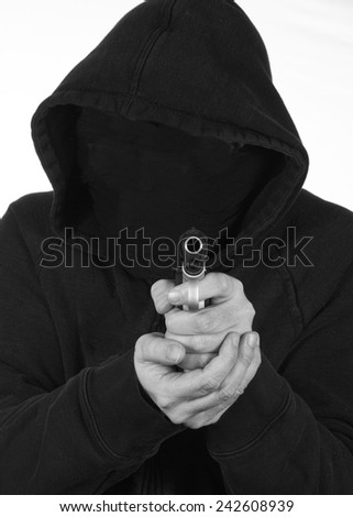 Terrorist points a gun - stock photo