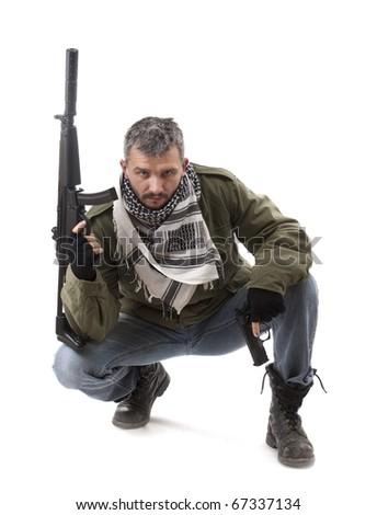 Terrorist with gun, isolated on white background - stock photo