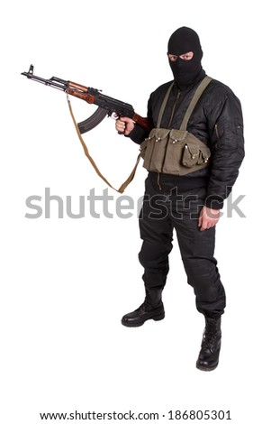 terrorist with Kalashnikov isolated - stock photo