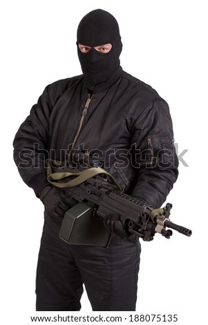 terrorist with machine gun isolated - stock photo