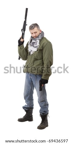 Terrorist with weapon and gun, isolated on white background - stock photo
