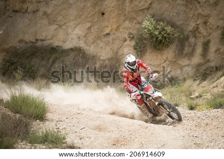 TERUEL, ARAGON/SPAIN - JULY 19: rider, Armando Ugarte, tries to get a good result on SS3 in Baja Aragon Rally on July 19, 2014 in Teruel - stock photo