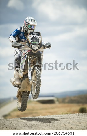 TERUEL, ARAGON/SPAIN - JULY 19: rider, Kevin Dardaillon, tries to get a good result on SS1 in Baja Aragon Rally on July 19, 2014 in Teruel - stock photo
