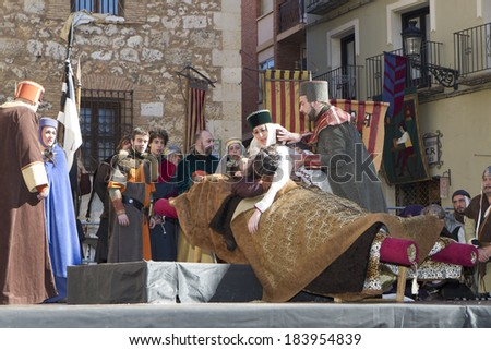 TERUEL, SPAIN - FEBRUARY 23 2014: Participants during rendering of the medieval festival of Bodas de Isabel de Segura recreating the legend of the Lovers of Teruel during the third weekend in February