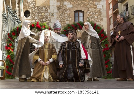 TERUEL, SPAIN - FEBRUARY 21 2014: Participants during rendering of the medieval festival of Bodas de Isabel de Segura recreating the legend of the Lovers of Teruel during the third weekend in February - stock photo