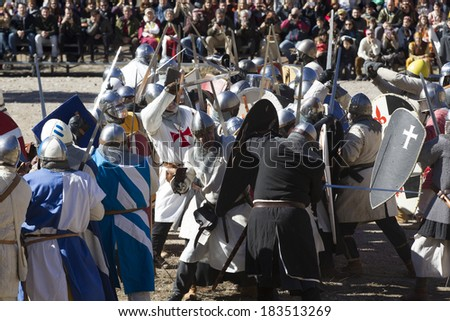 TERUEL, SPAIN - FEBRUARY 22 2014: Participants during the representation of a medieval battle taking place within the party The Marriage of Isabel de Segura in Teruel every month in February.