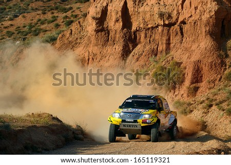 TERUEL, SPAIN - JUL 7 : Polish driver Martin Kaczmarski and his codriver Bartlomiej Boba in a  race in the XXX Baja Spain, on Jul 7, 2013 in Teruel, Spain. - stock photo