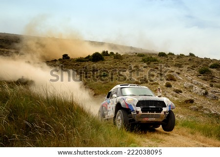 TERUEL, SPAIN - JUL 19 : Russian driver Vladimir Vasilyev and his codriver Konstantin Zhiltsov in a Mini All4 Racing race in the XXXI Baja Spain, on Jul 19, 2014 in Teruel, Spain. - stock photo