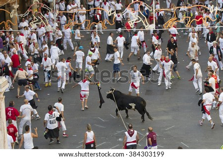 Teruel, Spain-July 13, People run from bulls on street during Vaquillas festival in Teruel, Spain on July 13, 2015  - stock photo