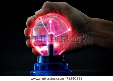 Tesla Ball Emitting Electrical Currents - stock photo