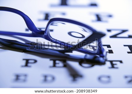 Test chart and eyeglasses.Studio shot - stock photo