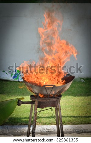 test explosion in a kitchen fire. The result of putting water on an oil fire. - stock photo