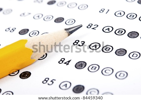 Test score sheet with answers and pencil - stock photo