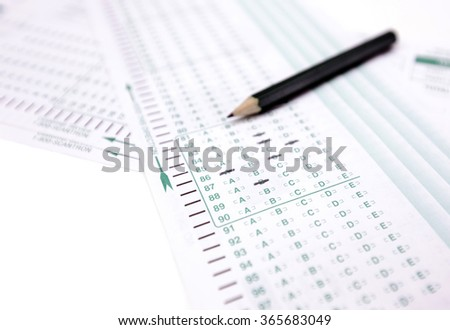 Test sheet paper with answers and pencil isolated on white - stock photo
