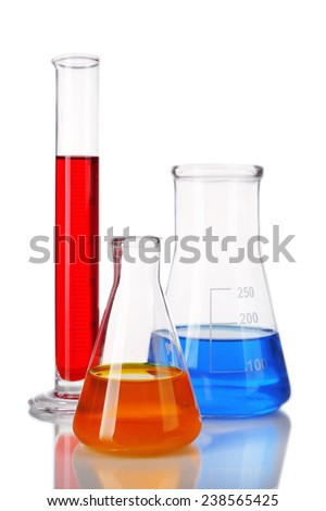 Test-tube and flasks with colorful fluid isolated on white - stock photo