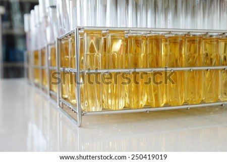 test tube  contain yellow media for microorganism in microbiology laboratory  - stock photo