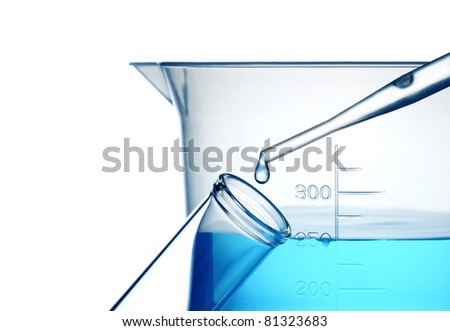 Test tube,dropper and blue liquid - stock photo