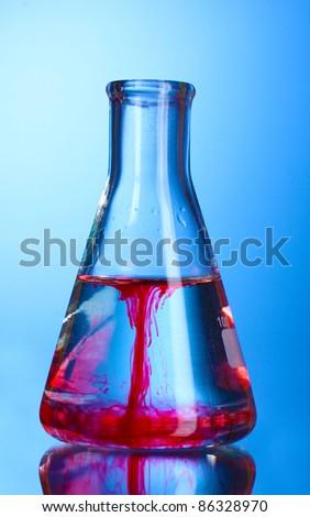 Test-tube on blue background - stock photo