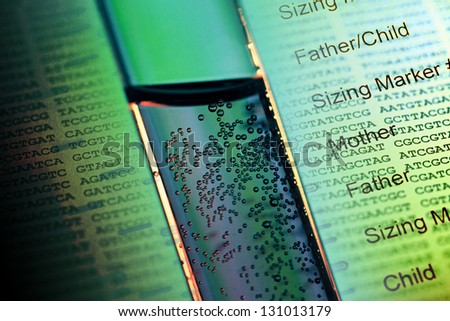 Test tube with air bubble in liquid material and DNA fingerprint - stock photo