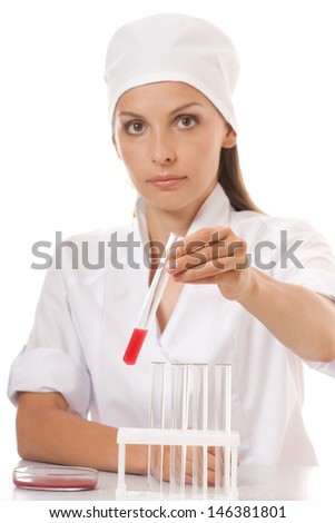 Test tube with blood sample in doctor hand, isolated - stock photo