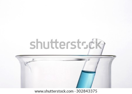 Test tube with blue(cyan) liquid(fluid, water) in the beaker for chemical, health at the laboratory and white background.